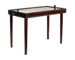 A folding mahogany campaign tray/side table, 66x41x50cm high