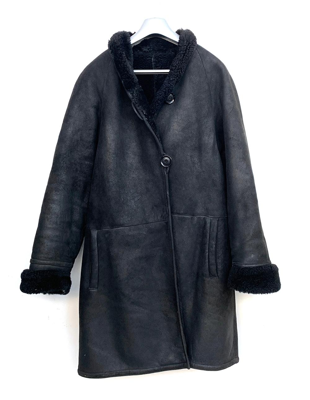 A Mani black sheepskin coat, size 40