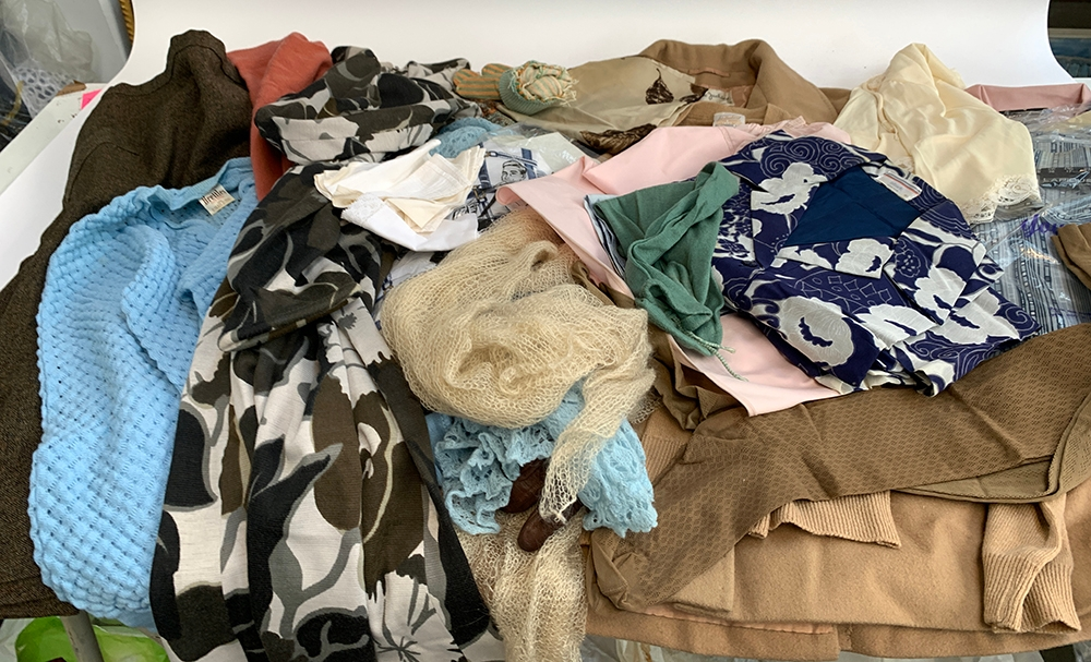 A large quantity of vintage clothes, to include a Maude Jackson camel hair coat; a leather
