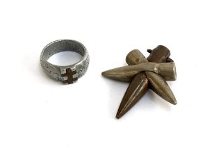 An aluminium trench art ring with copper inlay design and floral engraving; together with a trench