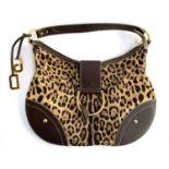 A Dolce & Gabbana leopard print handbag with COA