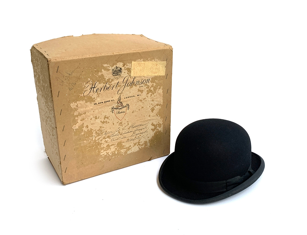 A Lock & Co. hatters black bowler, size 7 1/4, 20.8x16.3cm, together with a Herbert Johnson box