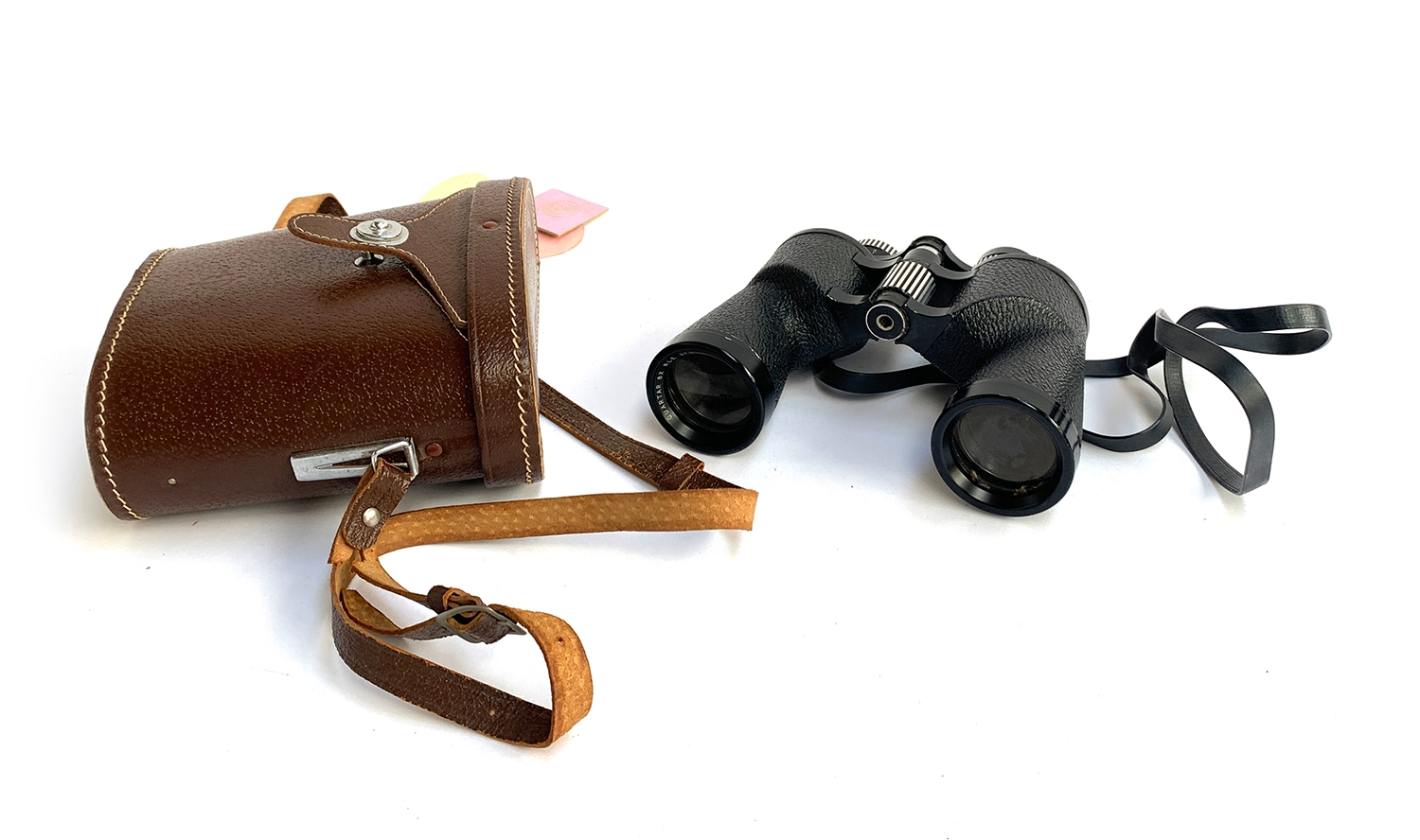 A pair of Swift Saratoga 8x40 binoculars in leather case with racing tags attached