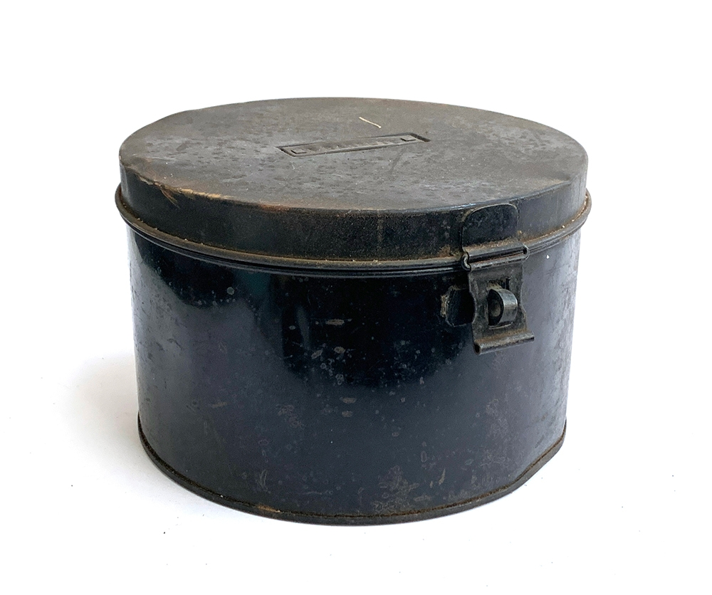A black painted metal hat box, with brass plaque reading 'A. Barnett'
