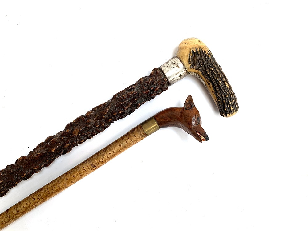 A substantial walking stick with plated collar and antler handle; together with one other with