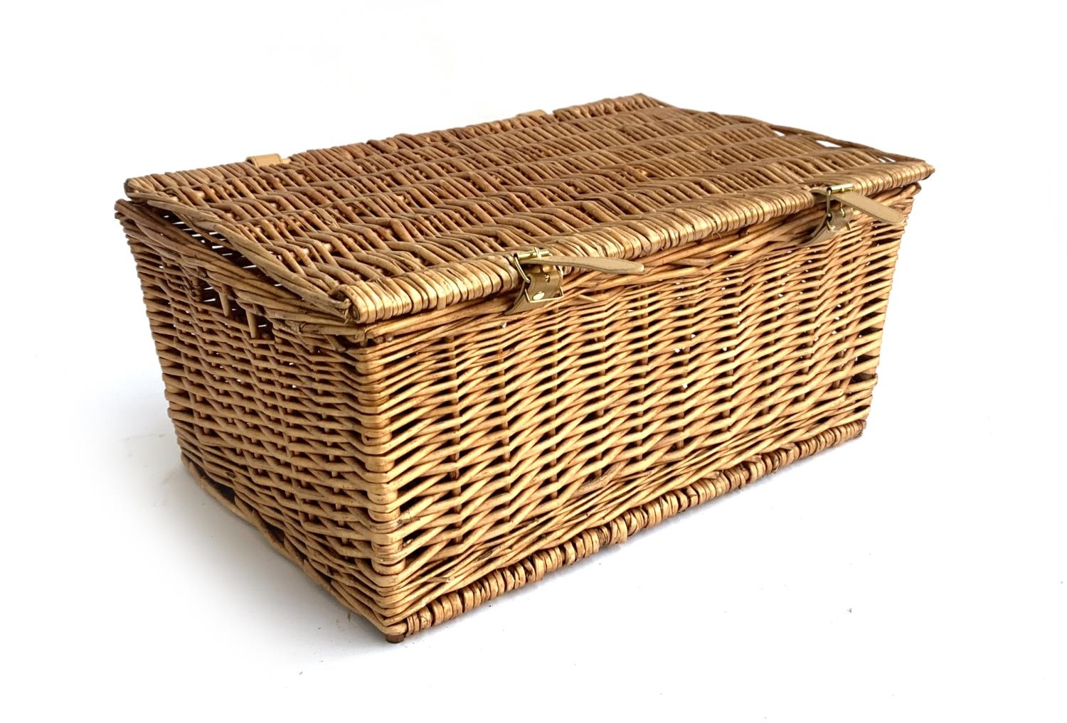 A wicker picnic hamper, with leather hinges and fasteners, 55cm wide