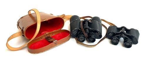 A pair of Air Port 10x50 field binoculars by Eikow, in a hard leather case; together with a pair