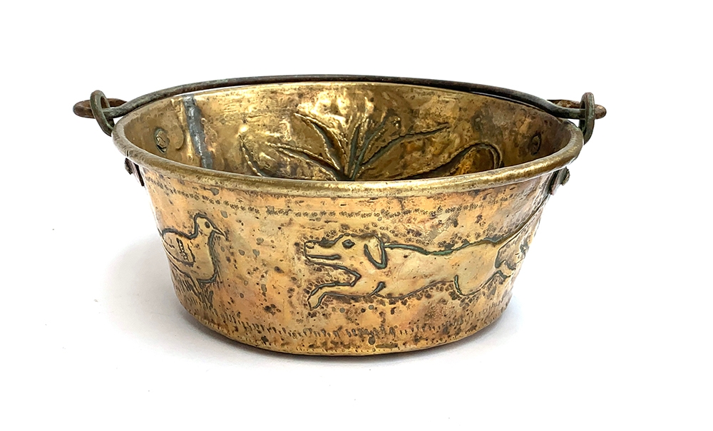A 19th century copper and brass pan, chased with gundog, pheasant, etc, 25cm diameter