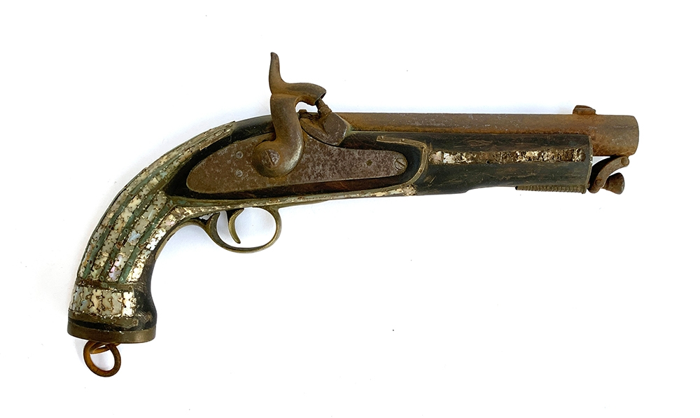 A percussion pistol, marked Tower 1858, with mother of pearl inlay