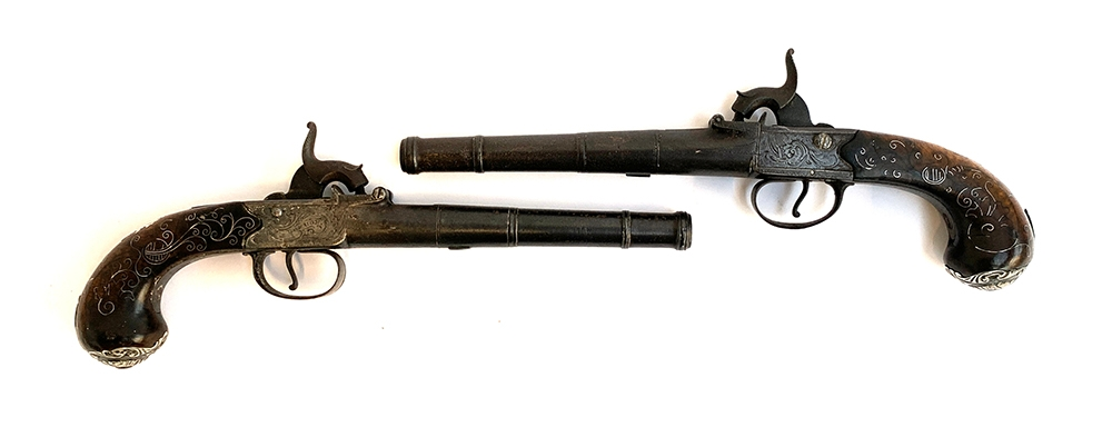 A pair of 19th century percussion duelling pistols, each having a 17cm Queen Anne type cannon