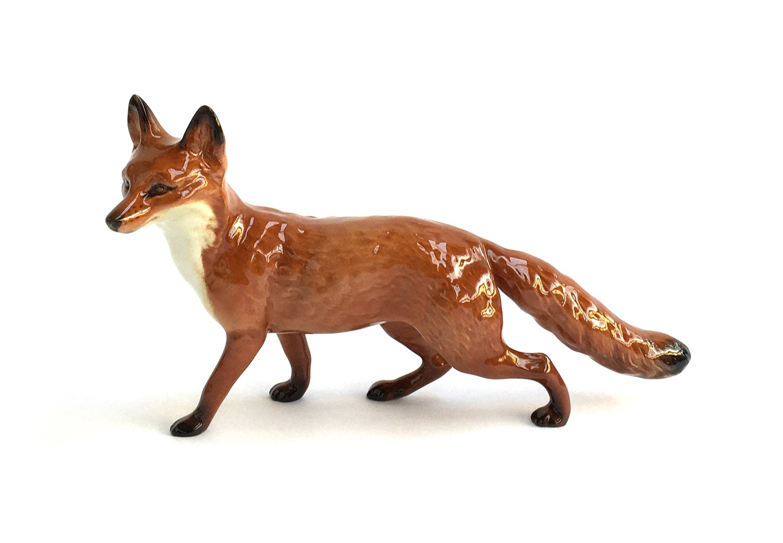 A Beswick figurine of a fox, approx. 23cmL