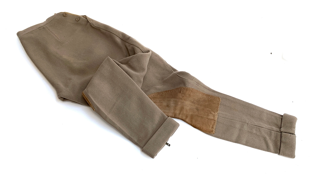 A leather and canvas jerkin, very large; together with a pair of twill jodhpurs with side - Image 2 of 2