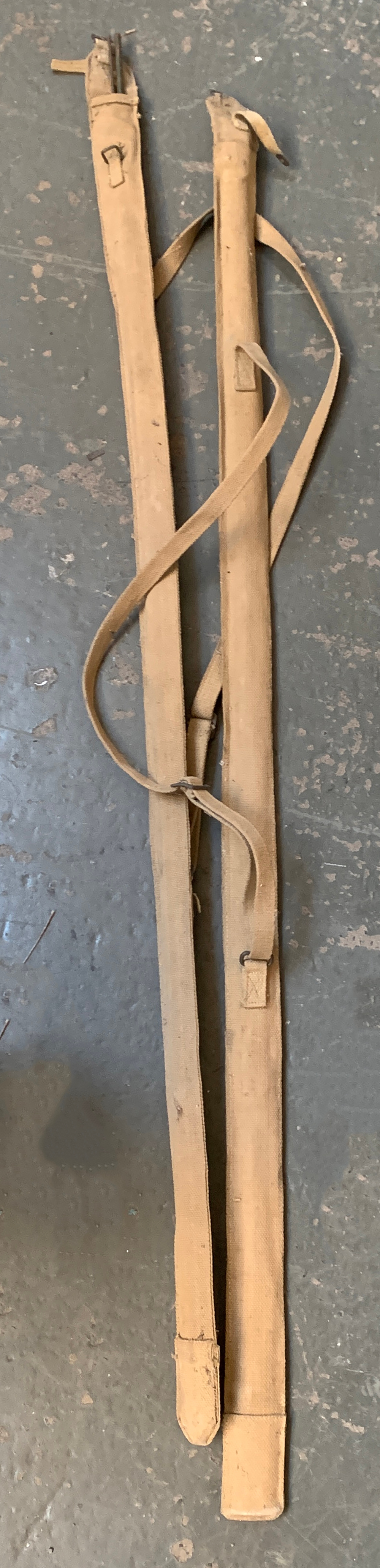 A pair of WWII collapsible Land Rover aerials in canvas clips, together with an ammunition box