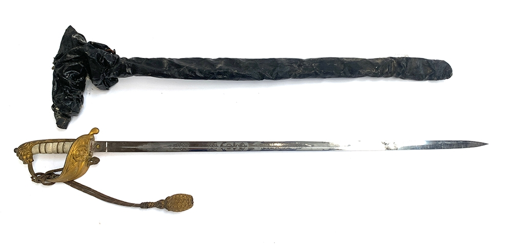 A Royal Navy Officers' dress sword with lion's head pommel, wire bound shagreen grip, Gothic