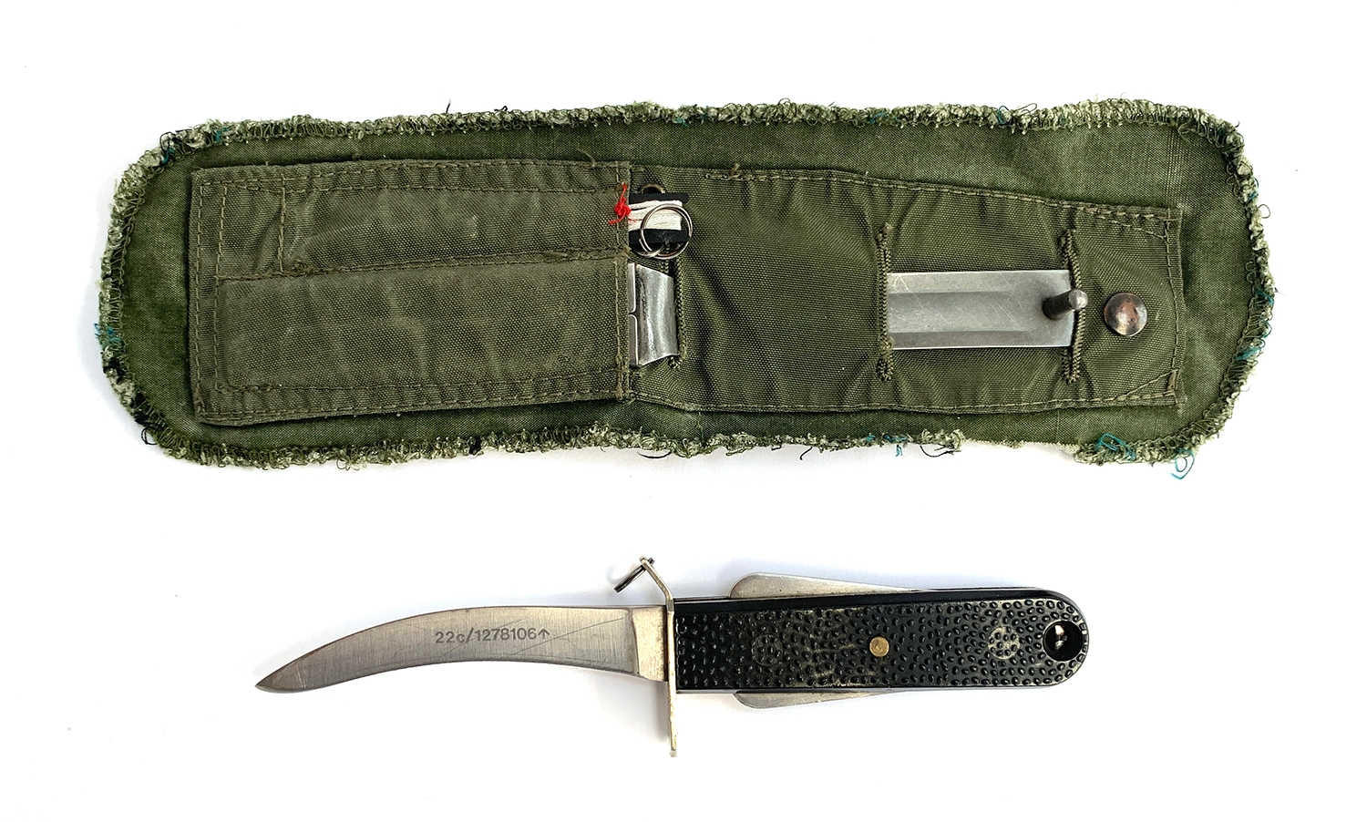 An RAF Mk3 Aircrew emergency survival knife with sheath and lanyard