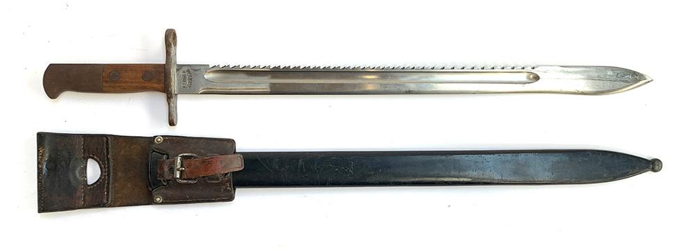 A Swiss M1914 sawback bayonet, marked 'Waffenfabrik Neuhausen' to ricasso, blade length 48cm, in