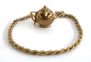 A 9ct gold ropetwist bracelet, 18.5cmL, approx. 1.8g; together with a 9ct gold teapot charm, approx.