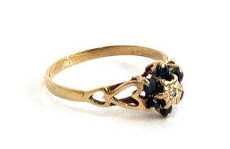 A 9ct gold sapphire and diamond ring, the band with pierced heart design, size O approx. 1.3g