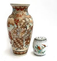 A Japanese satsuma style vase depicting court scenes, heightened in gilt, 33cmH, together with one