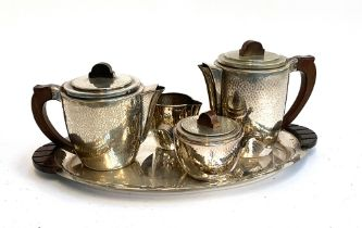 A stainless steel tea set and tray