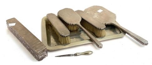 Various silver dressing table items to include brushes, looking glass, cut glass rectangular trinket