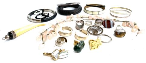 A quantity of jewellery to include various hallmarked silver earrings and rings set with hardstones;