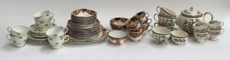 A Colclough tea set, 6 cups and saucers; Royal Stafford part tea set with two cake plates; Johnson