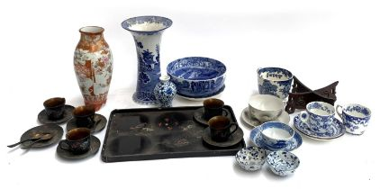 A mixed lot to include black Japanned teacups, saucers and tray; Japanese Satsuma style vase; blue