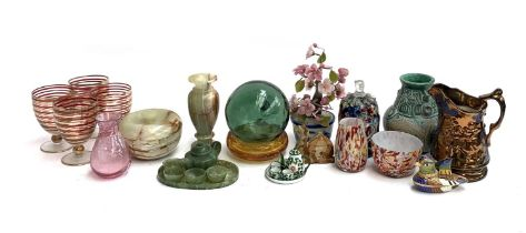A mixed lot to include onyx items, green glass fishermans float, hardstone decorative flower etc