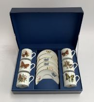 A cased set of six each Royal Worcester 'Butterflies' coffee cans and saucers