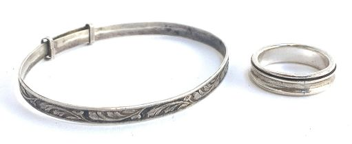 A silver bracelet with floral design, marked W.J.S, approx. 5.8g; together with a 925 silver