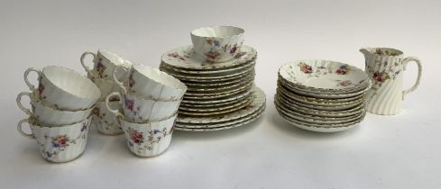 An Aynsley part tea service comprising 38 pieces, with floral gilt decoration