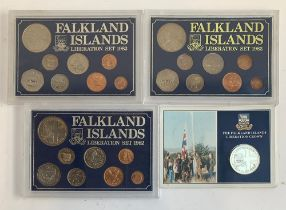 Three cased coin collections 'Falklands Islands Liberation Set 1982'; together with a cupro-nickel