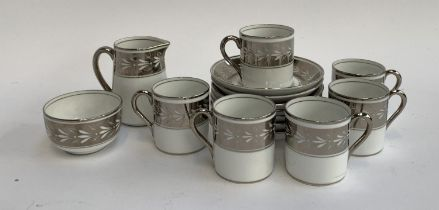 A T. Goode & Co. silvered part coffee set, comprising coffee cans (6) and saucers (7), milk jug