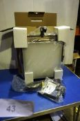 An F & V K4000 photography/video light, model 18020102, RRP £275.00, together with R300 L bracket,