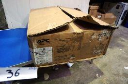 An APC Smart UPS, model SMT750RM2UNC - New in box, box tatty (ES3)