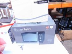 1 x Swan Retro black microwave, model SM22030BN, together with 1 x Swan 2.5ltr fryer, model SD6O8ON,