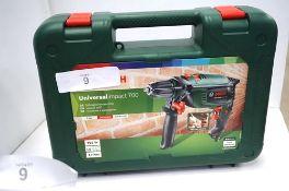 1 x Bosch Universal Impact 700 230V drill, model 0603131000 - Sealed new in box (TC3)