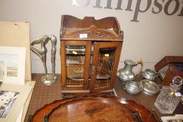 An early 20th Century oak and glazed smokers cabinet