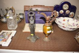 A pottery and gilt metal mounted baluster ewer; and a spelter lamp base in the form of a maiden with