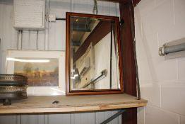 A bevel edged wall mirror