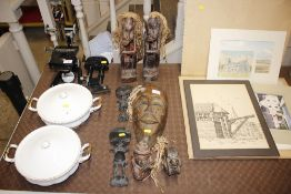 A collection of carved wooden African figures