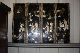 An oriental black lacquered and mother of pearl four fold table screen AF