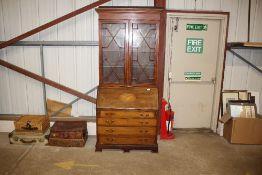 An Edwardian inlaid mahogany bureau bookcase
