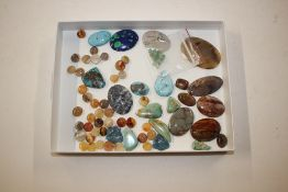 A tray of hard stone and turquoise mounts etc.