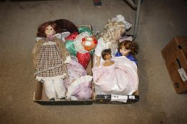 Two boxes of various dressed dolls