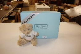 A boxed Rosy Bear with shawl