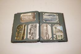 A vintage postcard album and contents