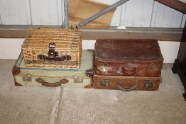 Three vintage suitcases and a wicker hamper