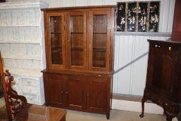 A G-plan oak bookcase on cupboard